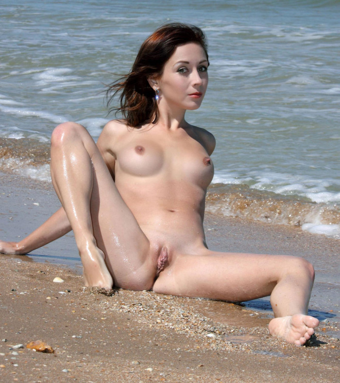 Very short-hair girl with beautiful body on the rocks