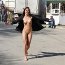 Young girl naked on the street