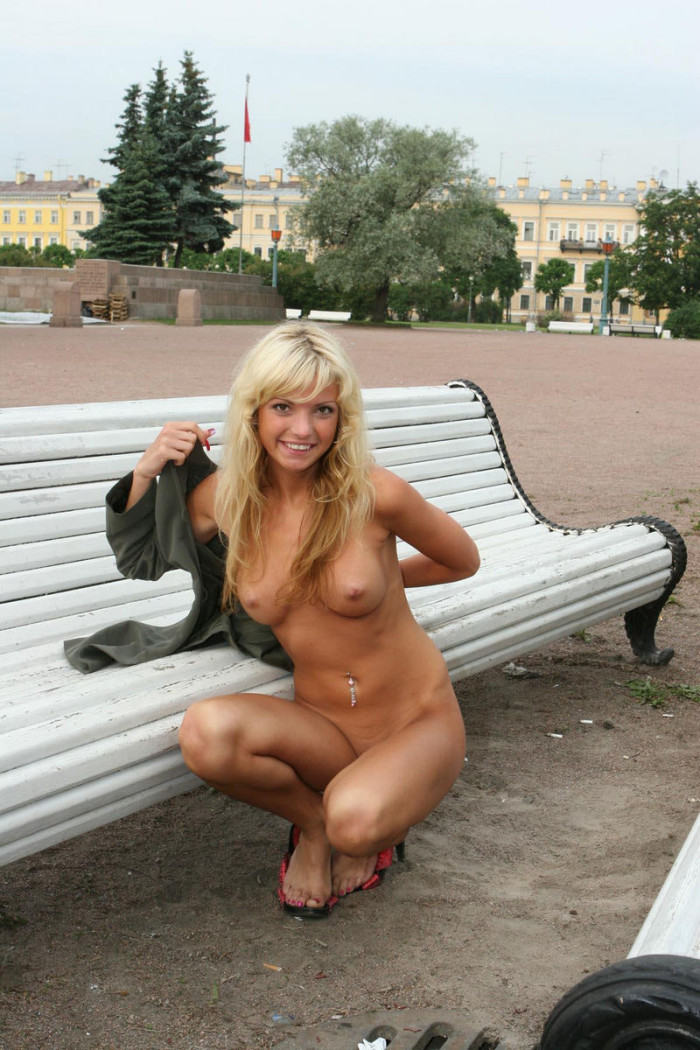 Naked girl selects souvenirs in the resort town
