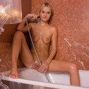Leggy blonde in the bathroom