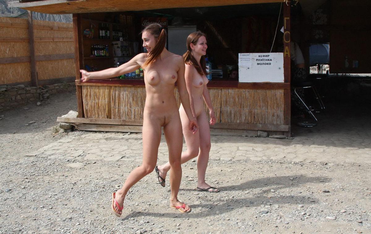 Naked women walking on beach