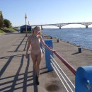 Naked girl with small tits on the waterfront