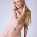 Lovely blonde undresses at studio