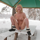Blonde with big beautiful pussy pee on the snow