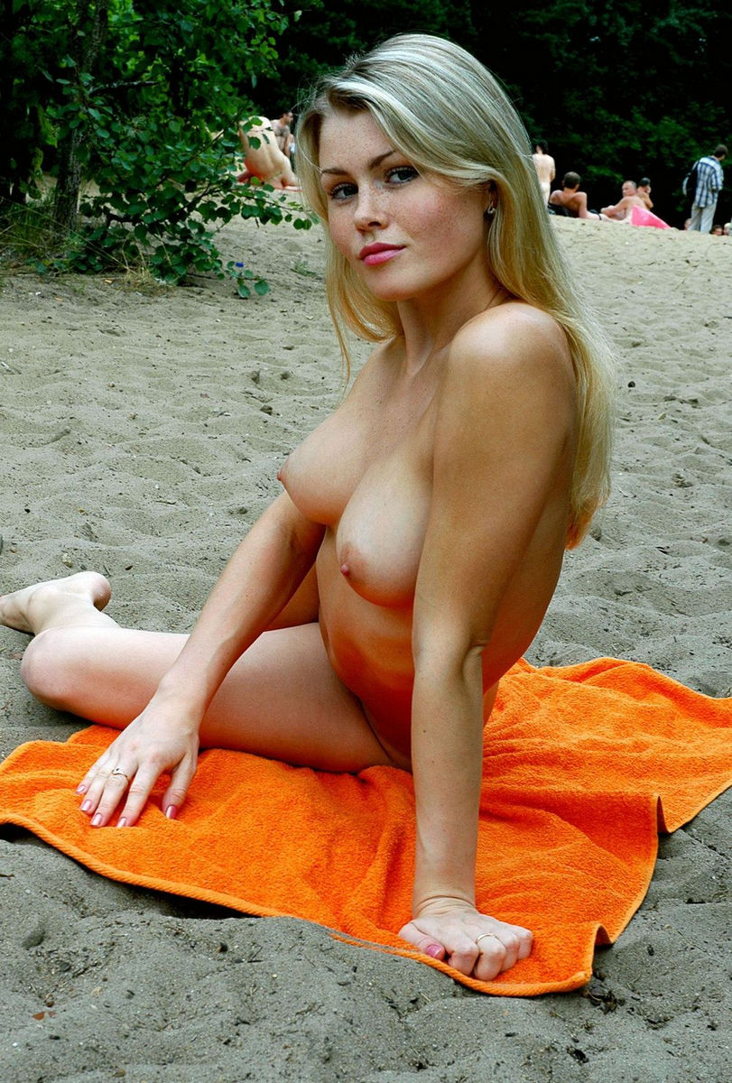 Cute girl naked in beach