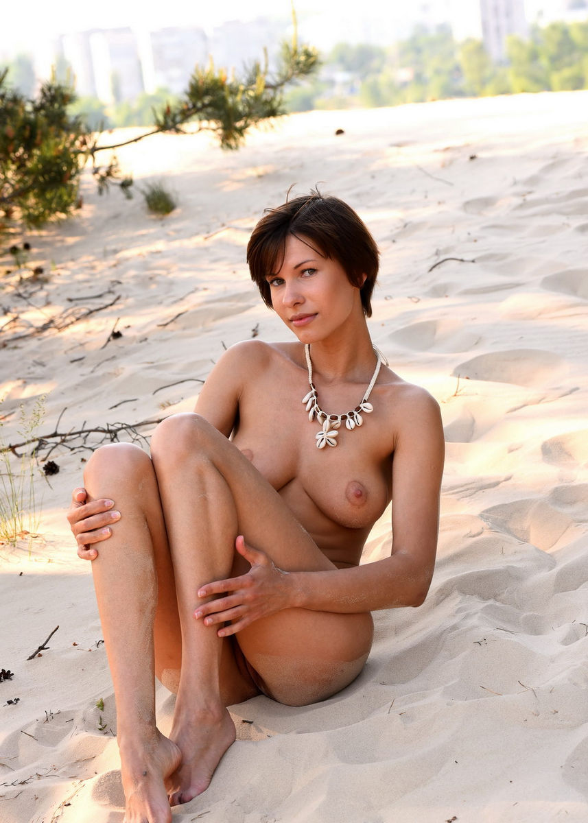 Nude woman at the beach