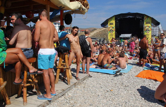 naked nudist babe drinks some tekila at public beach bar russian