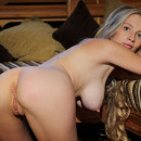 Long-haired blonde Gyana A at countryhouse