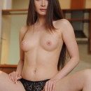 Alluring Angel Spice bares her gorgeous body and sweet pussy as she poses on the   sofa.