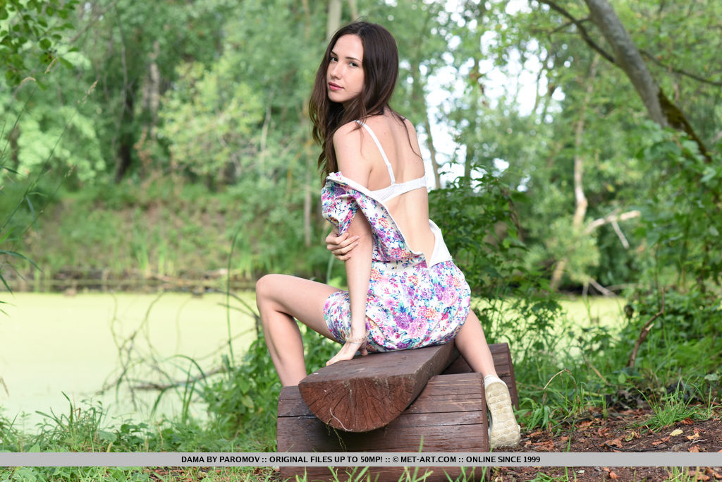 New mode Dama strips in the outdoors as she flaunts her slender body with beautiful   tits.