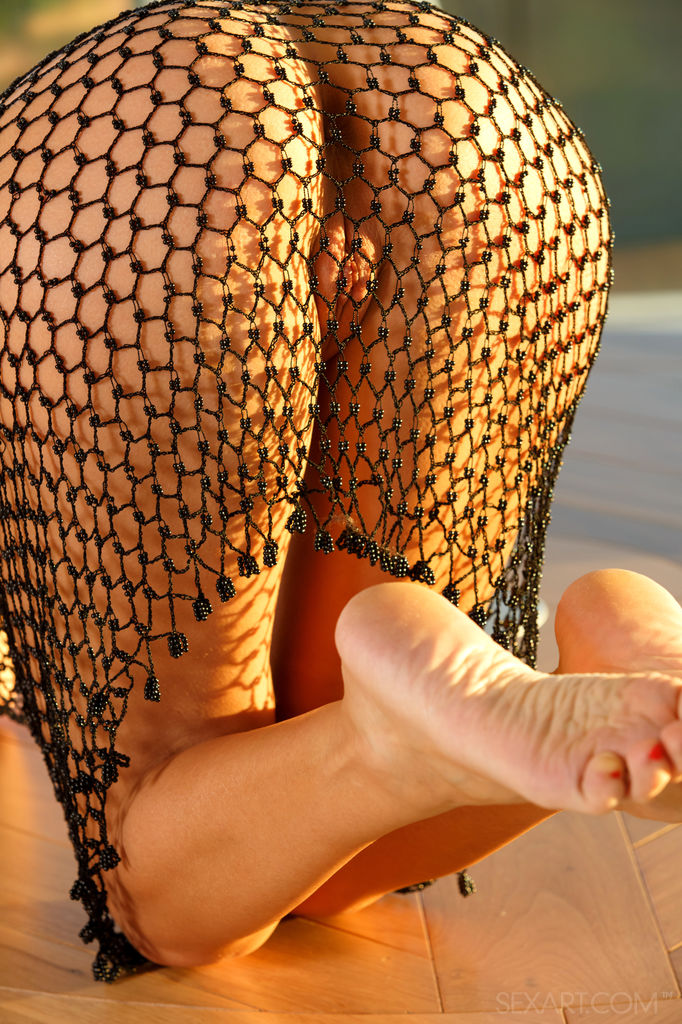 Mango A's delectablly smooth body with puffy nipples and shaved pussy clad in a fishnet dress