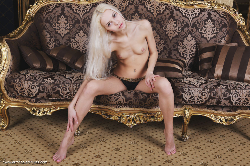 Blonde Leonie bares her slender, tight body and sweet pussy on the couch.