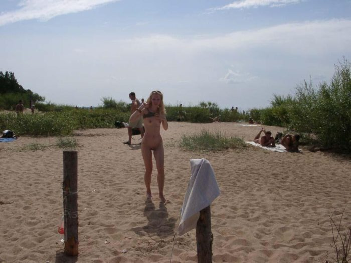 Blonde sunbathing naked at public beach