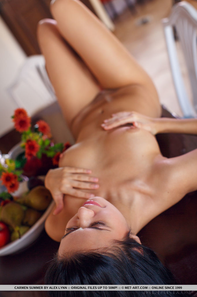 Carmen Summer bares her sexy, tight body as she performs an erotic striptease on the   table.