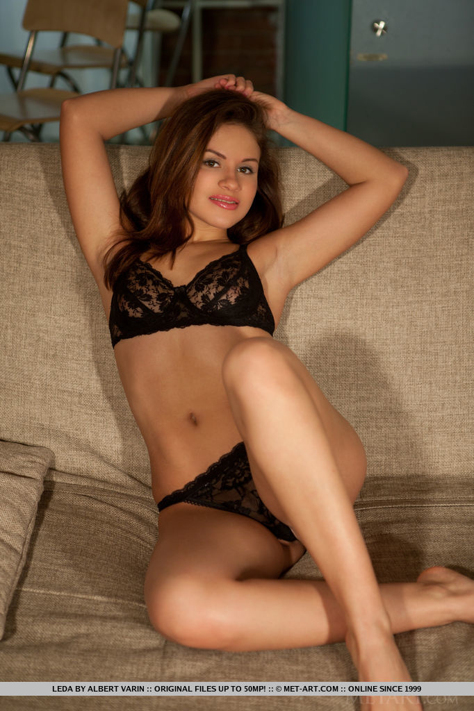 Leda A playfully stripping off her black lace lingerie to show off her smooth, petite bod