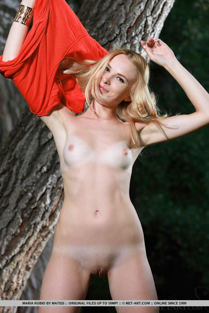 Maria Rubio displays her slender body with pink perky nipples as she poses on the grass.