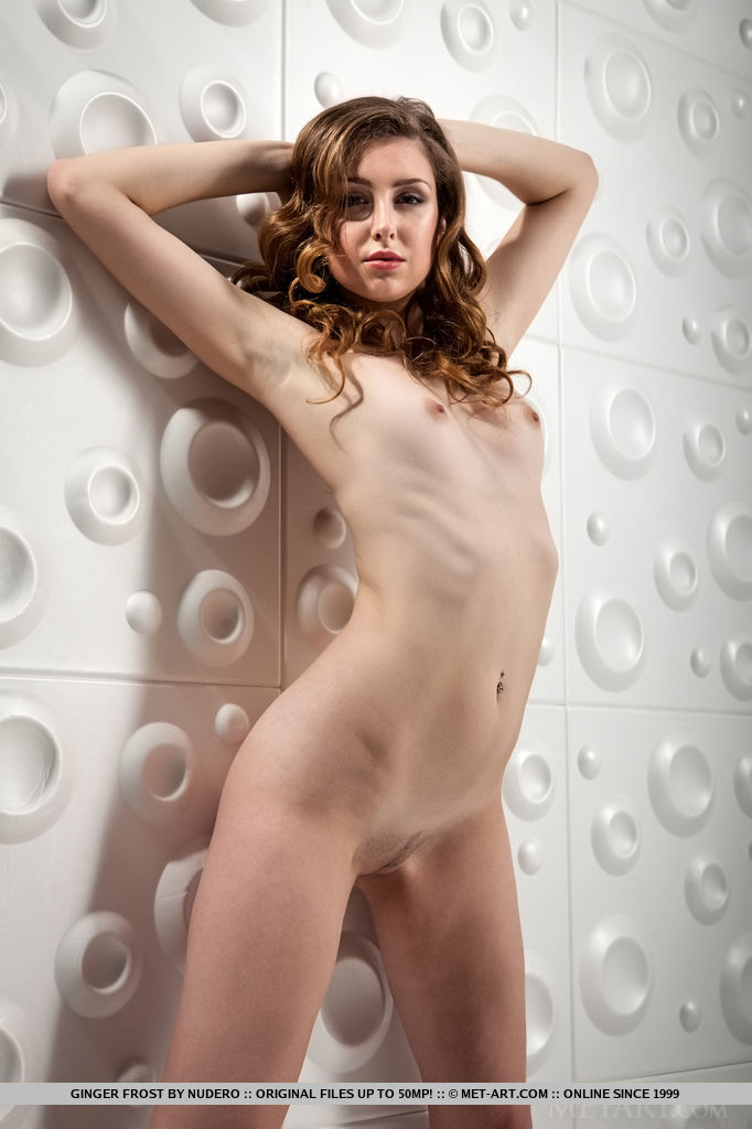Newcomer Ginger Frost flaunts her sexy, slender body with small tits as she poses   sensually in front of the camera.