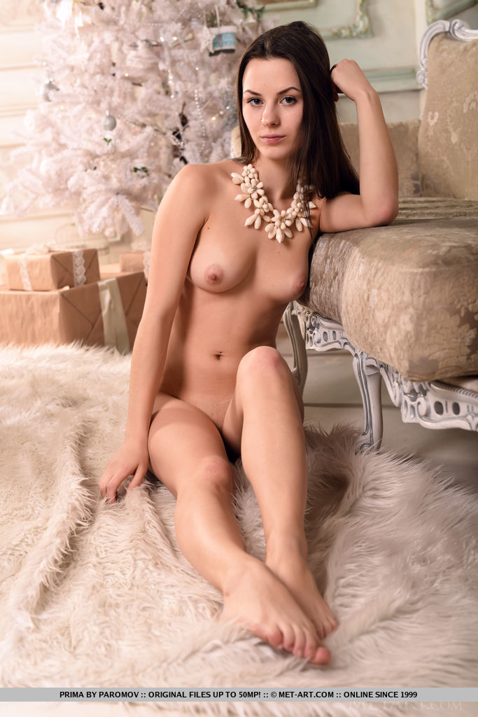 Prima displays her sexy, naked body with beautiful breasts and amazing ass as she poses   on the elegant chair.