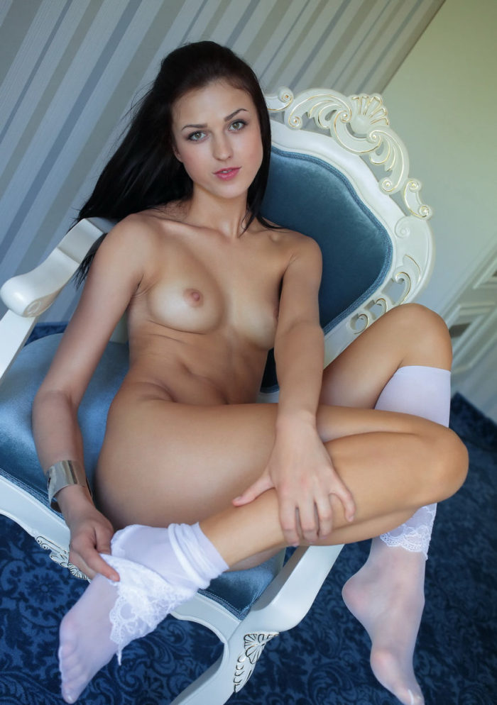 Sexy brunette in white stockings shows her tight shaved pussy