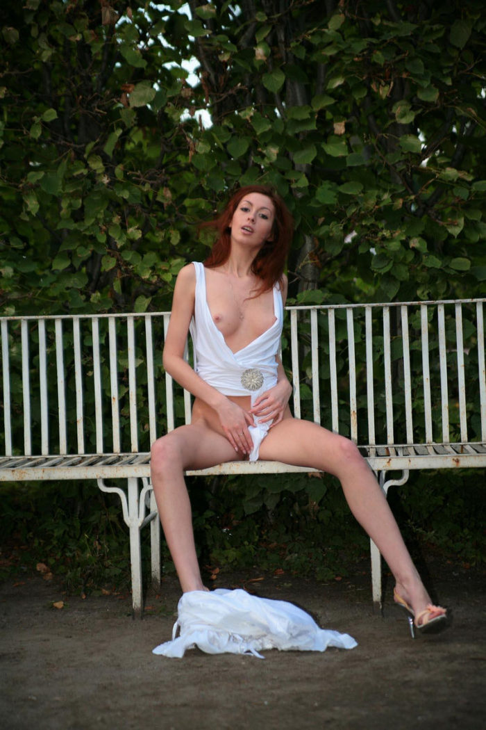 Very beautiful redhead babe shows pussy at public park