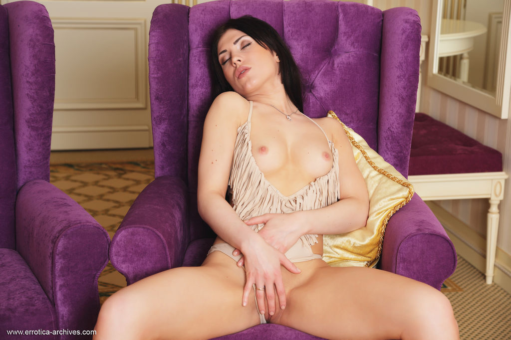Sasha Bree shows off her luscious body and delectable pussy as she poses on the sofa.