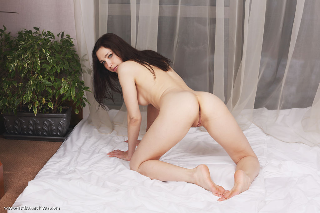 Oliviana bares her naked, creamy body and yummy pussy as she poses on the   bed.