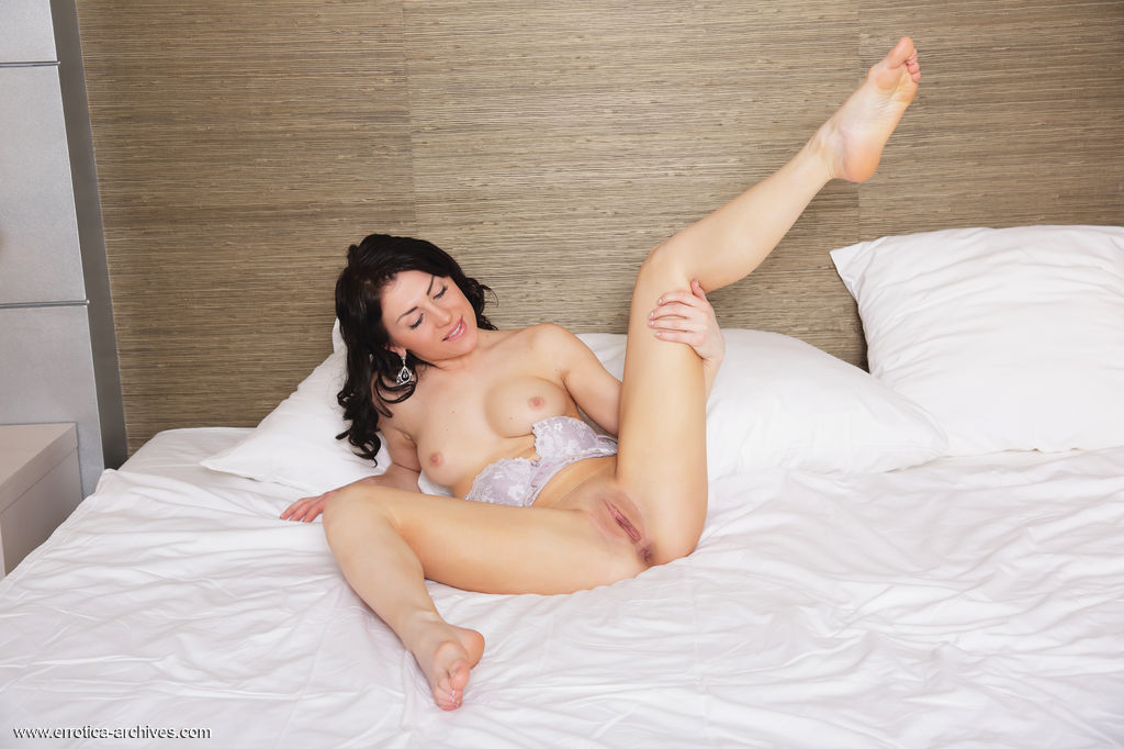 Sasha Bree strips her sexy lingerie baring her sweet pussy and gorgeous breasts as she poses on the   bed.