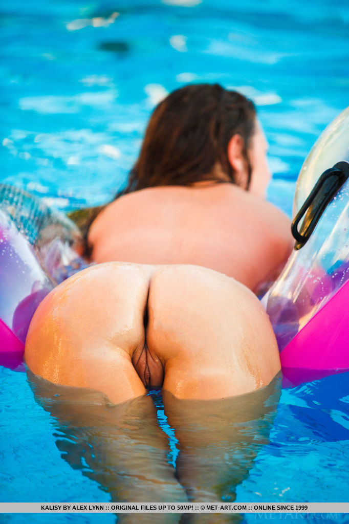 Kalisy takes a leisurely dip in the pool before playfully stripping off her two-piece bikini