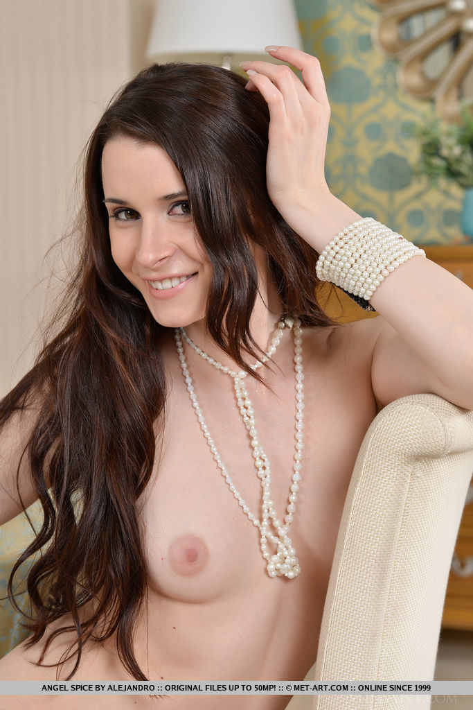 Angel Spice takes off her bodycon dress, posing naked for the camera with a sweet yet naughty smile
