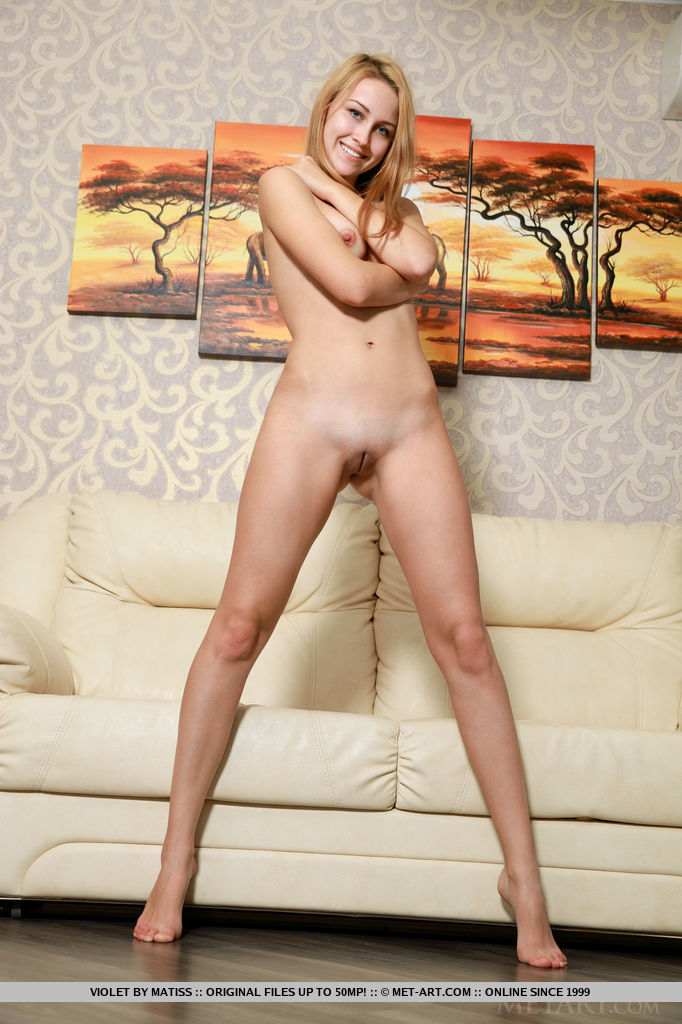 Violet shows off her meaty ass and yummy pussy as she poses on the sofa.