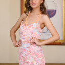 Maslyn takes off her long floral dress, revealing her slender body with nubile assets
