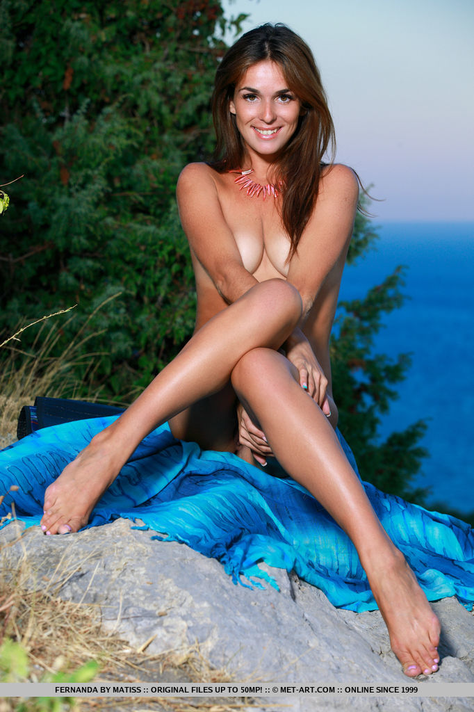 Fernanda playfully poses in the outdoors as she flaunts her tanned body.
