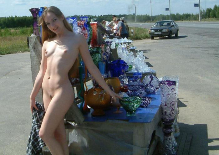 Amateur small-tittied teen flashes at road market