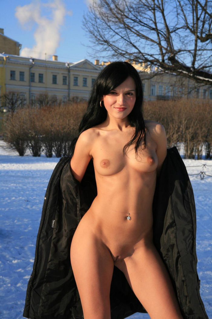 Bare brunette at winter public park