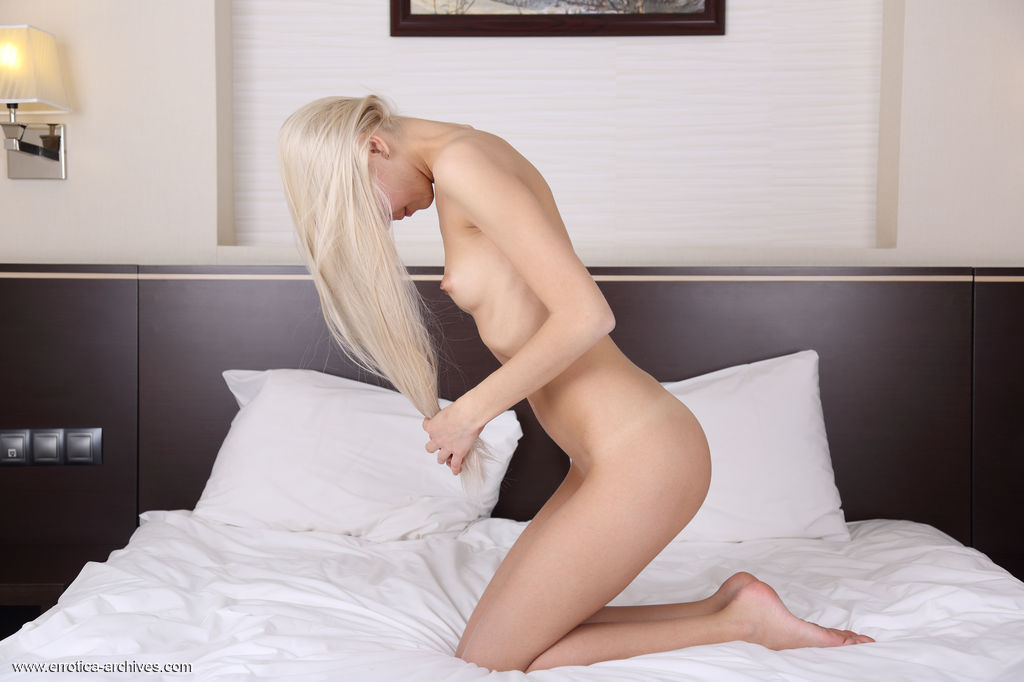 Beautiful Leonie displays her sexy, slender body and sweet pussy as she poses on the   bed.