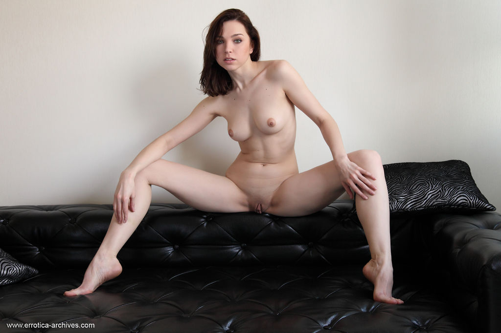 Beautiful Oliviana bares her creamy white body with pink nipples and sweet pussy as she poses on the couch.