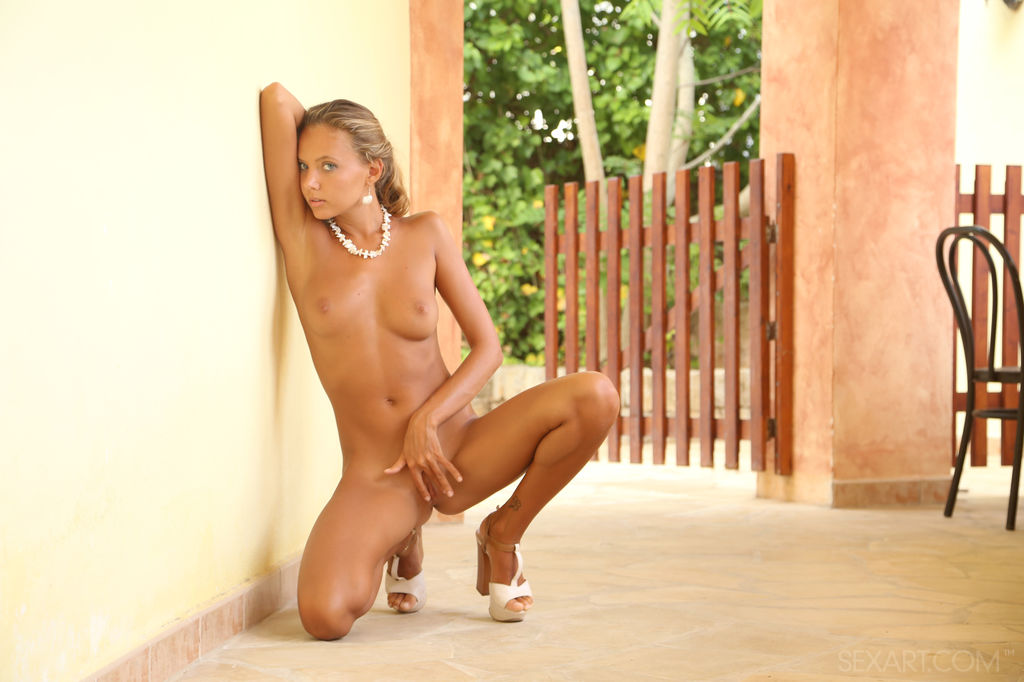 Blue-eyed goddess Mango A showing off her petite body, perfectly tanned complexion, and smooth, puffy body