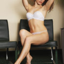 Curly Eva Kane strips her white lingerie baring her gorgeous body and delectable pussy   as she poses on the table.