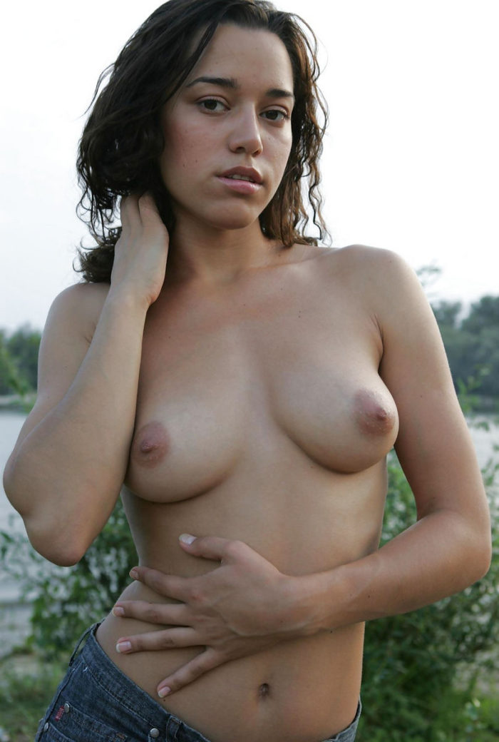 Gorgeous Genevieve Gandi flaunts her creamy white body, beautiful breasts   with pink nipples and yummy pussy on the flowery field.s