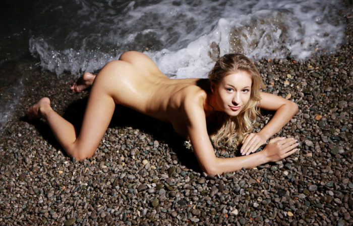 Curly blonde Felicity at night beach