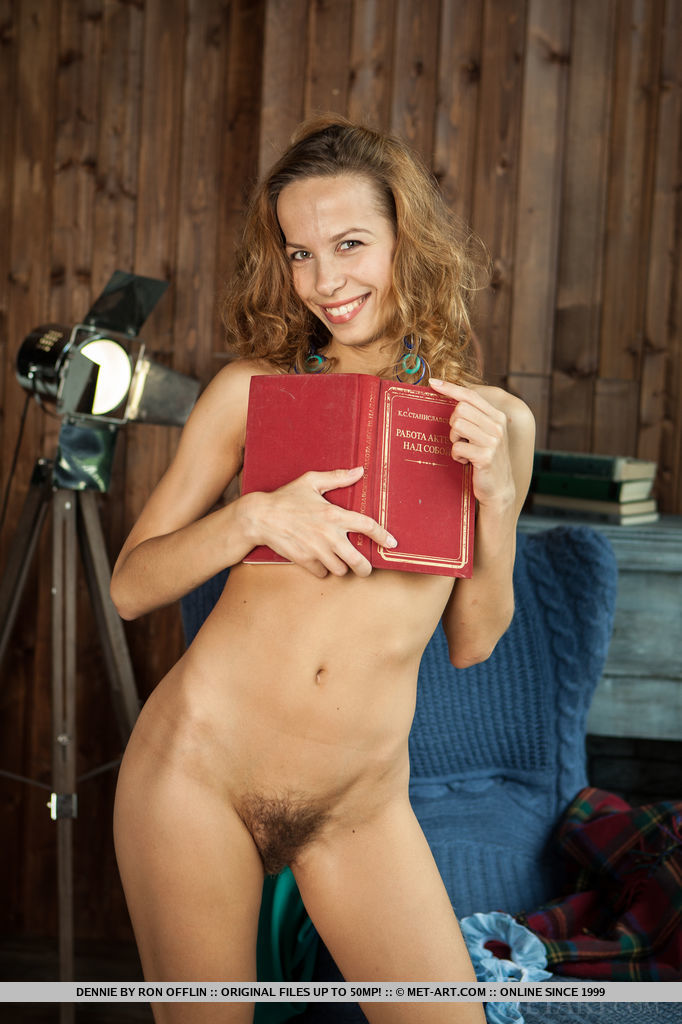Dennie takes off her dress and underwear, showing off her long and slender body with gorgeous, unshaved pussy