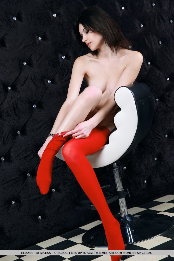 Elizabet strips her red lingerie baring her creamy, white body as she sensually poses in front of the camera.