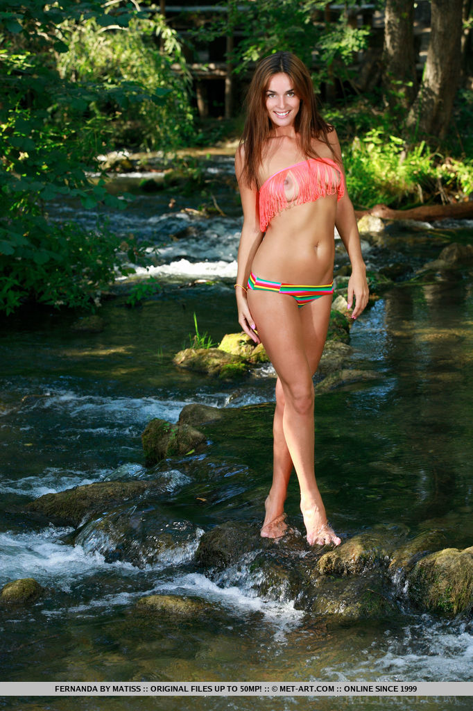 Fernanda poses in her two-piece bikini by the river, her slim silhouette with sexy, leans legs stands out