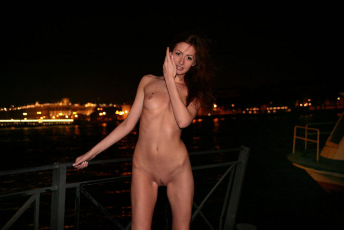 High-rise skinny red-haired beauty at night pier