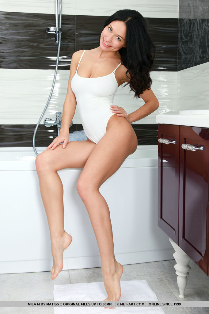 Mila M strips her one-piece bikini as she bares her wet, gorgeous body into the bathtub.