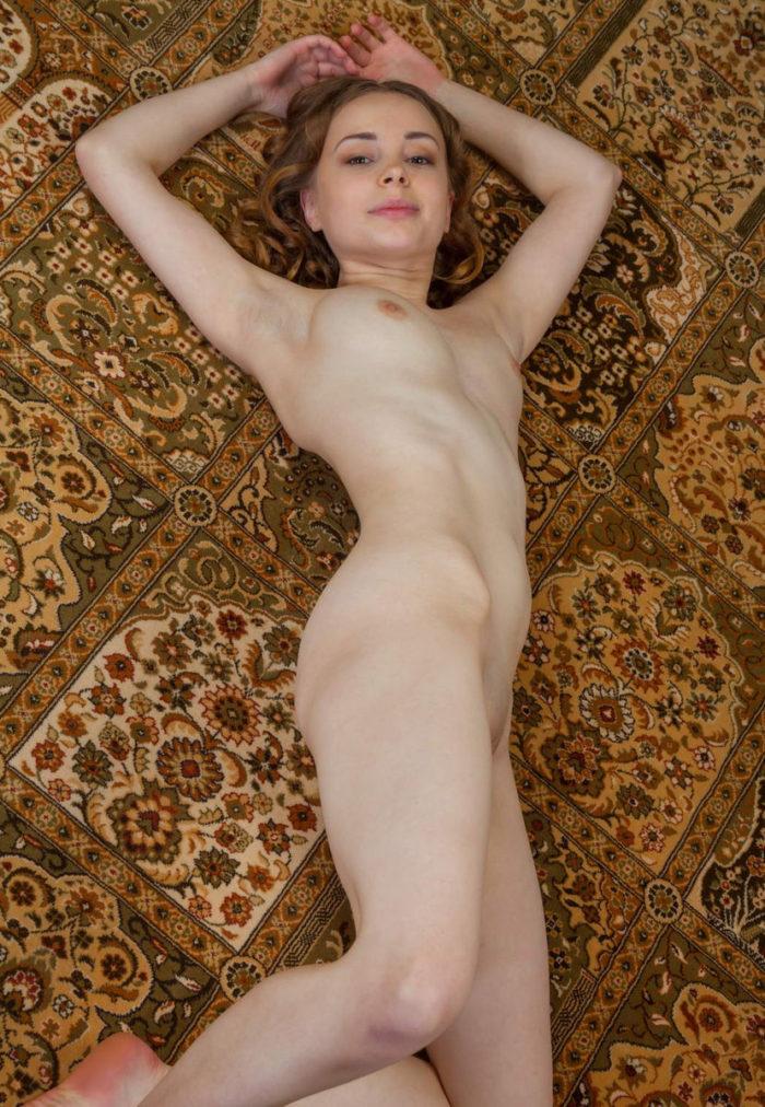 Pretty girl lying on the carpet
