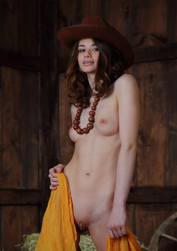 Sexy babe Loretta A showcasing her huge vulva in the barn