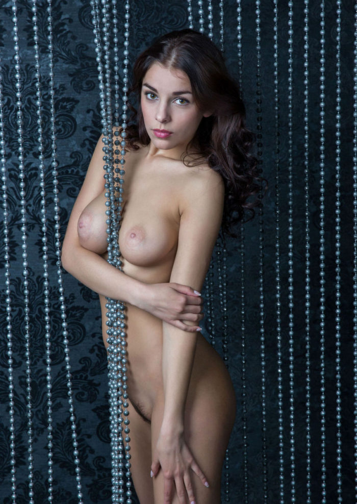 Sweet brunette Evelina shows her amazing boobs and yammy pussy