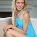 Tamara F takes off her powder blue dress that compliments her blonde hair, blue eyes, and smooth, fair body