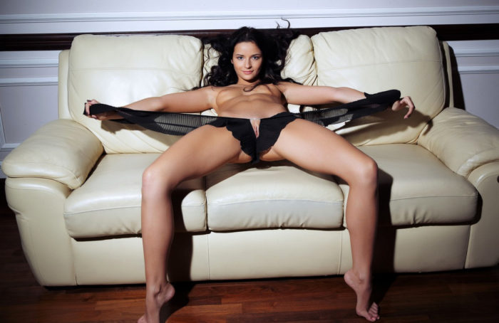 Young brunette Ardelia A on white sofa